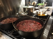beans stewing with cured pork on the stove