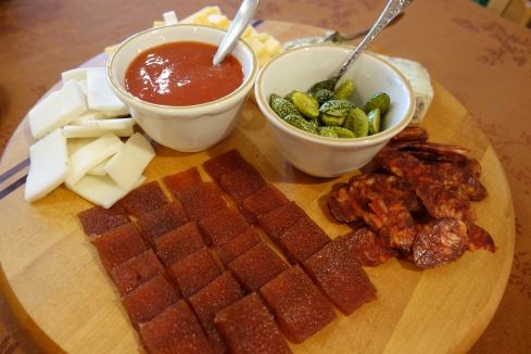 Appetizers including pickled Mexican cucumbers and tomato jelly