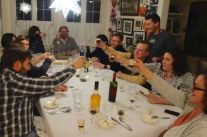 dinner guests toast the meal with carajillos