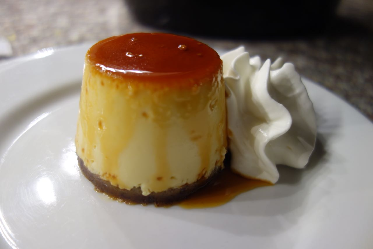 Flan with bienmesabe crust and cardamom and buttermilk whipped cream