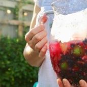 pitcher of blueberry Caipirinhas