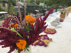 Flowers from Root and Heart Farm. Vintage straw trivets decorate the table.